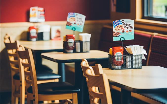 Inside Dairy Queen Grill & Chill Dining Area Tables